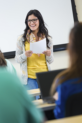Photo of young woman presenting to a class